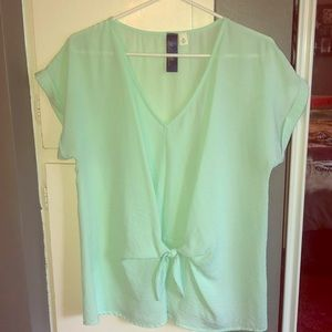 Mint green blouse with bow detail